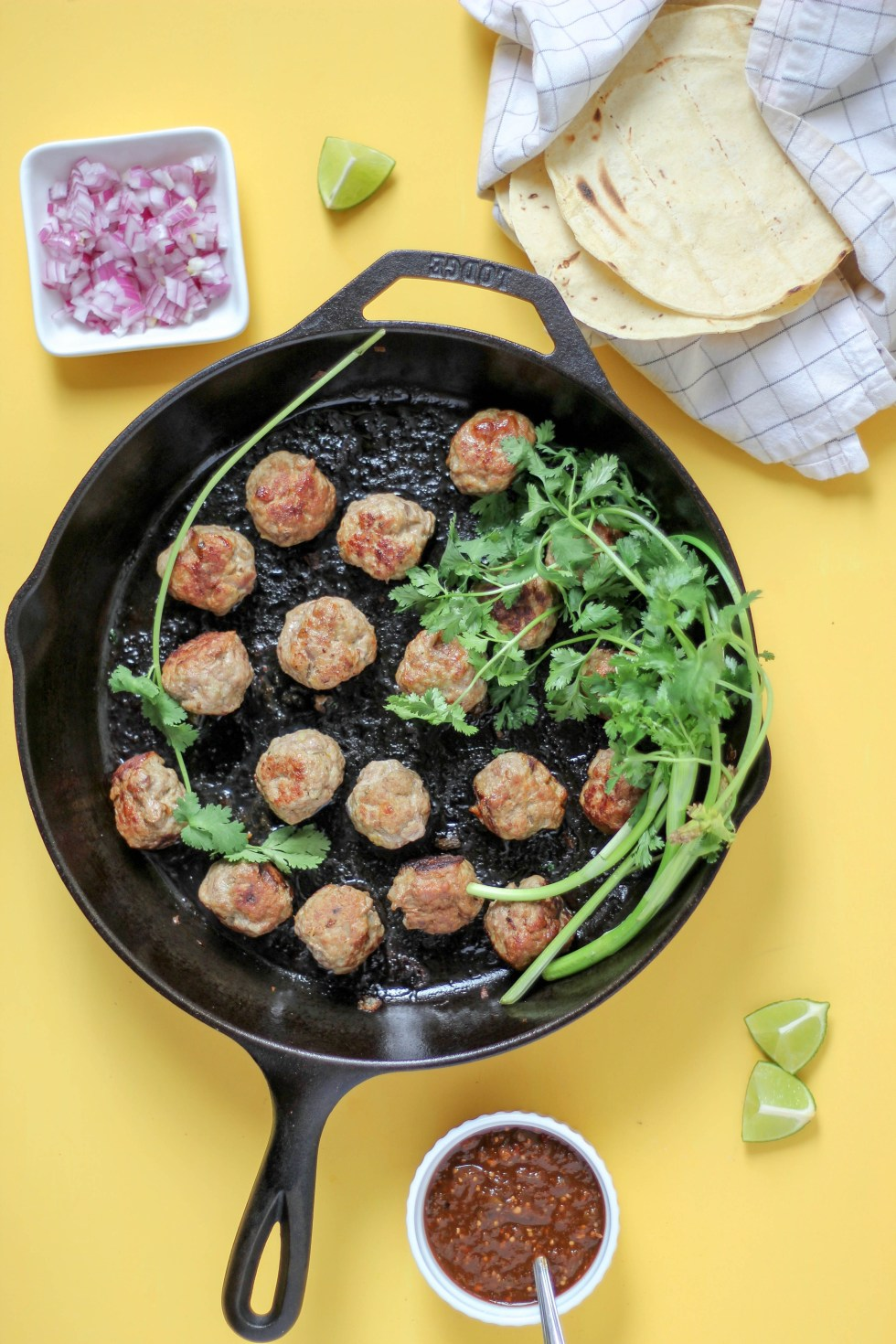Juicy meatballs with caramelized edges, mounded up with onions, cilantro, and guac. Carnitas Meatball Tacos are an easy, weeknight variation of classic carnitas. Use lentils and make them vegetarian!