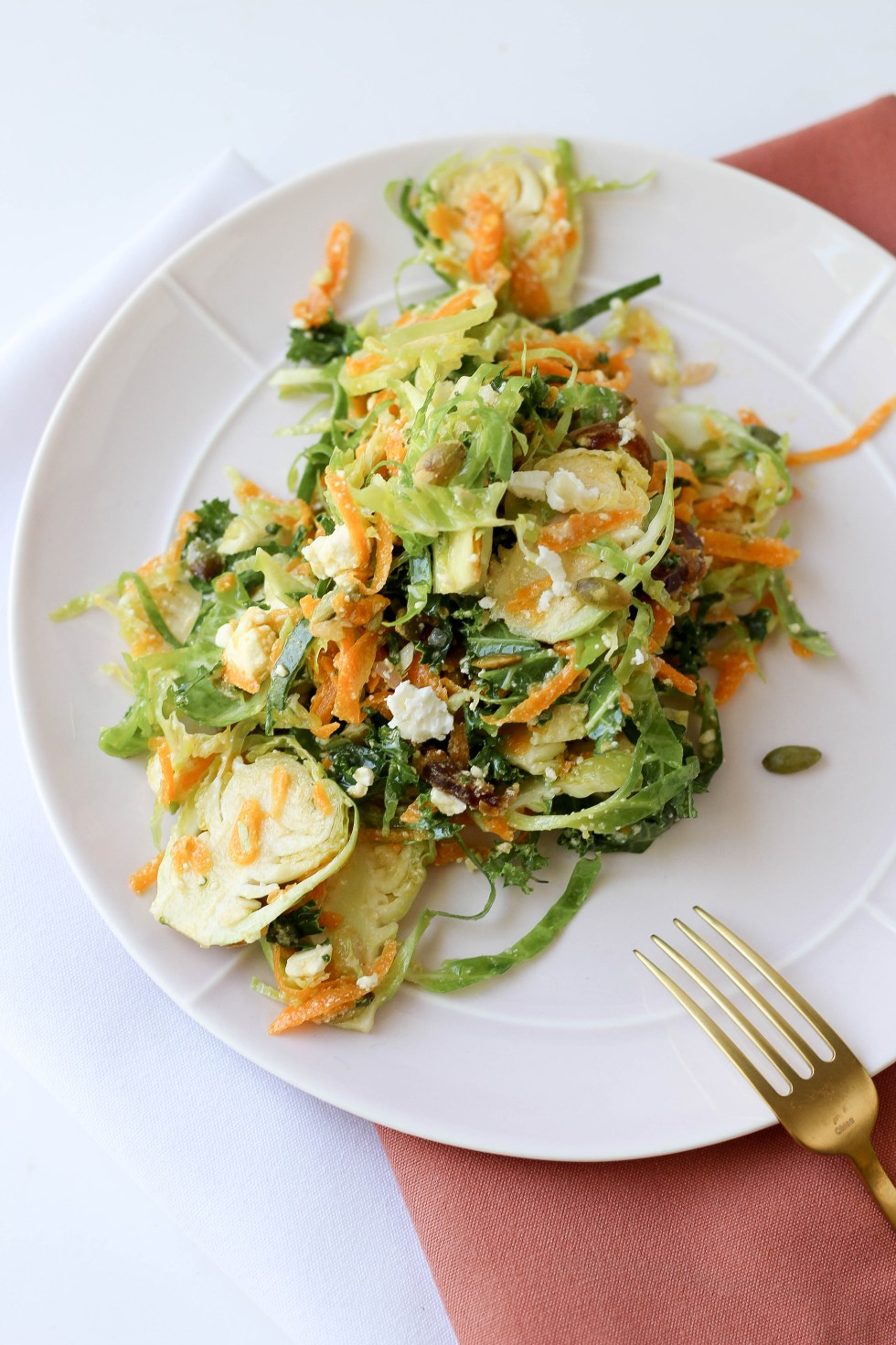 Shaved brussel sprout salad with butternut squash, champagne vinaigrette, feta dates, and pepitas // POP KITCHEN