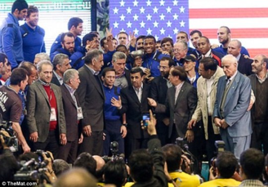 Iranian president Mahmoud Ahmadinejad poses with the US freestyle national team (dailymail.co.uk)