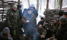 Dmitri Jarosh parla ad alcuni militanti di Pravy Sektor che combattono al fronte.