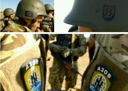 Alcuni volontari del battaglione Azov combattono indossando elmetti delle divisioni Ss della seconda guerra mondiale.