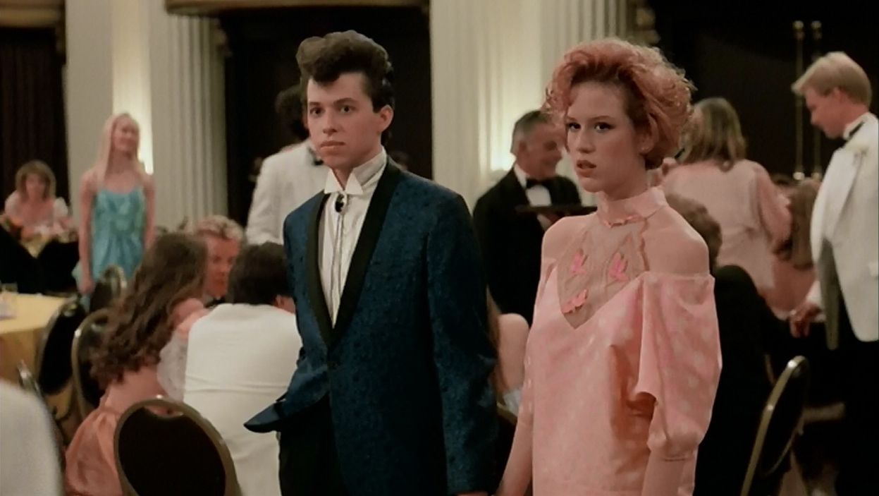Duckie and Andie spot Blane at the prom in the film's reshot ending.