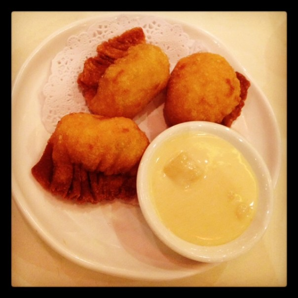 Deep fried prawn dumplings with salad sauce