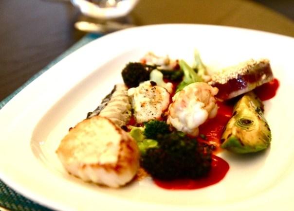 Seafood salad, tomato coulis, salmoriglio vinaigrette