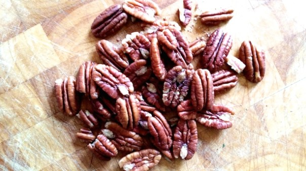 A large handful of pecan nuts