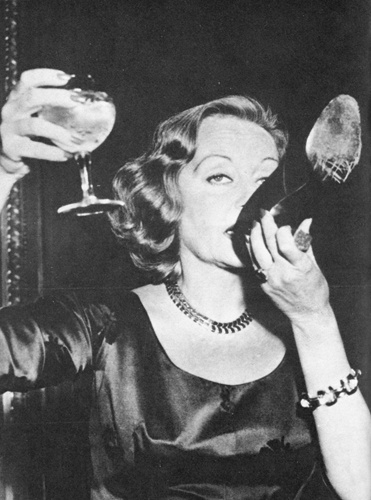 Tallula Bankhead drinking champagne out of her shoe at The Ritz 1951