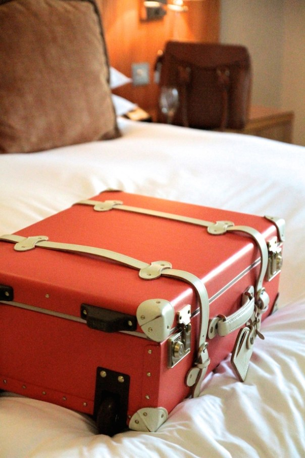 My Steamline Luggage suitcase on my very comfortable bed...