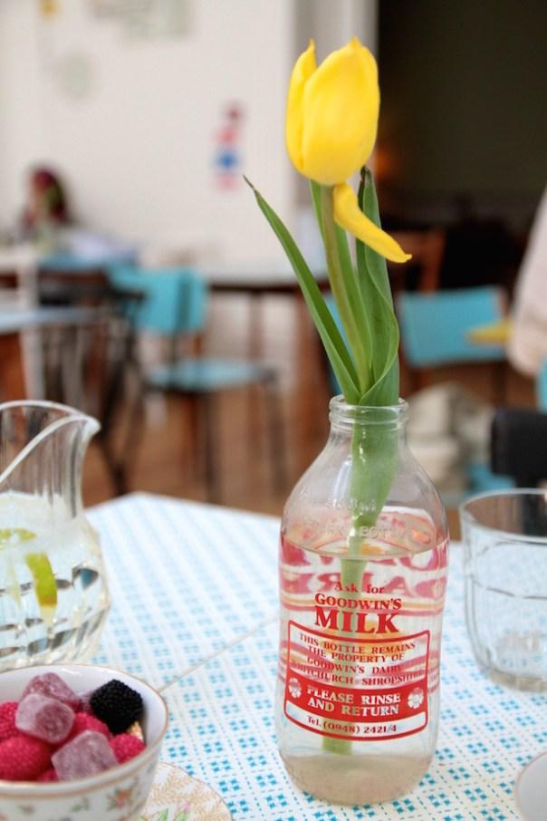 Tulips in a milk bottle