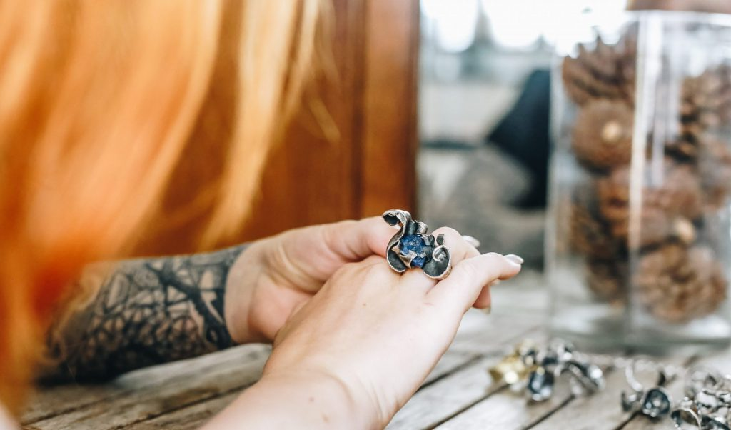 Jewellery by Poppy Porter red haired model wears a silver ring with Lapis Lasuli stone