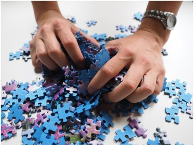 Person losing patience with complex puzzle