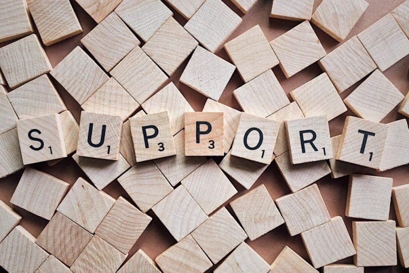 Blocks spell out SUPPORT, in reference to supporting customers