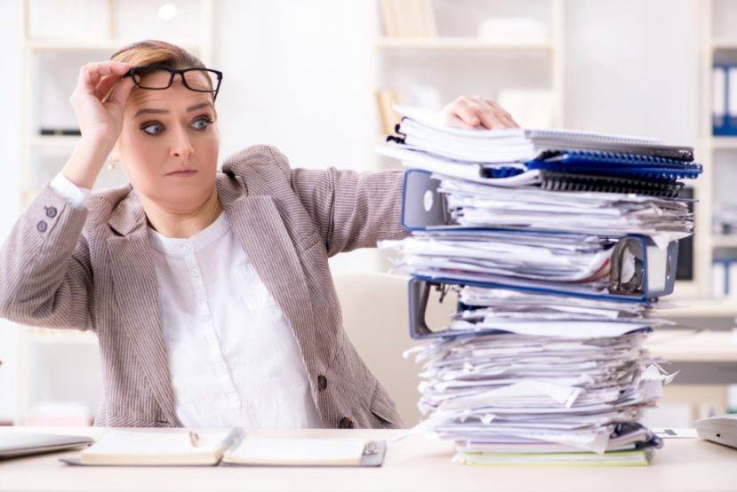 woman busy with audit papers