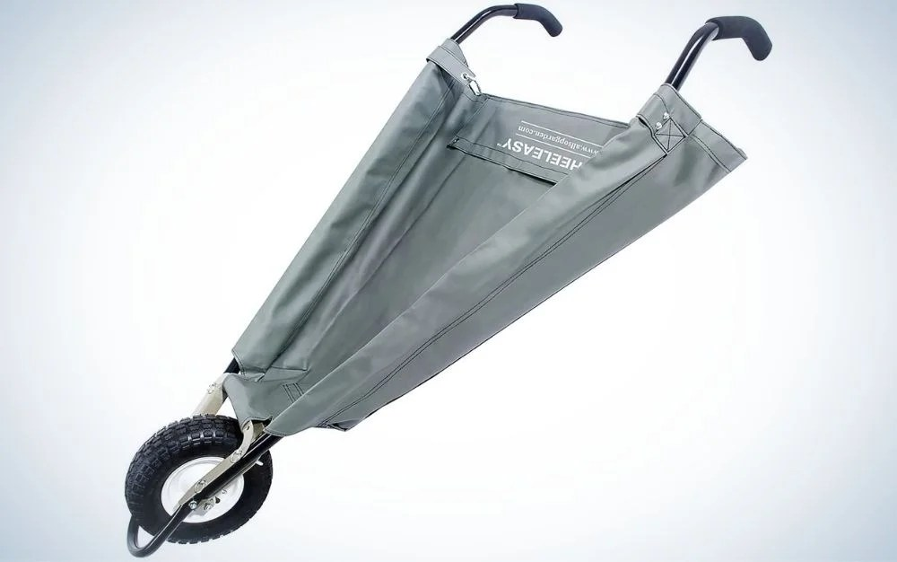 A small gray wheelbarrow with a black wheel and covered with a piece of cloth.