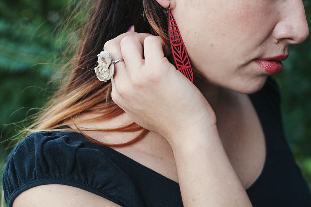 Val wearing potions gemstone rings and laser cut leather earrings | handmade jewelry at Pop Shop America from the Hallows Look Book | Shop Online Now