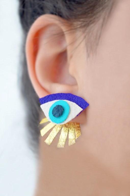blue seeing eye stud earrings ear jacket pop shop america