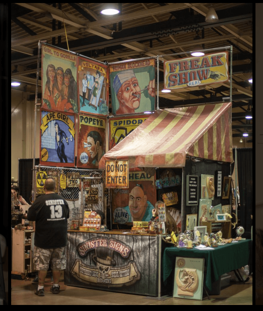 sinister signs booth display comicon