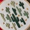 close up of multi cactus embroidery hoop art handmade in austin tx