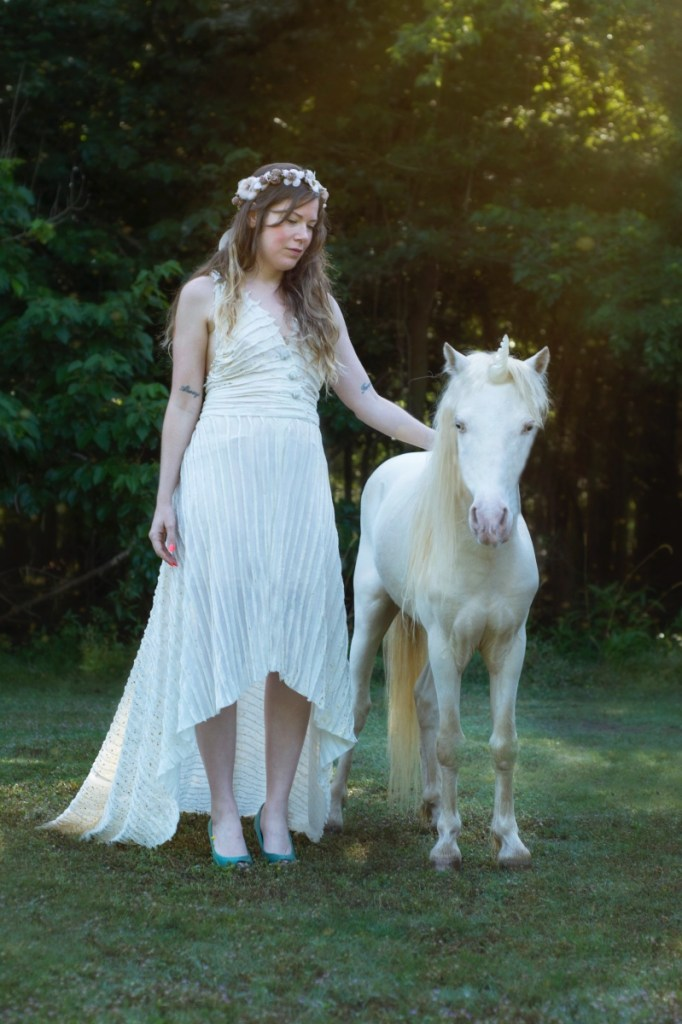 brittany bly petting unicorn magical photo shoot