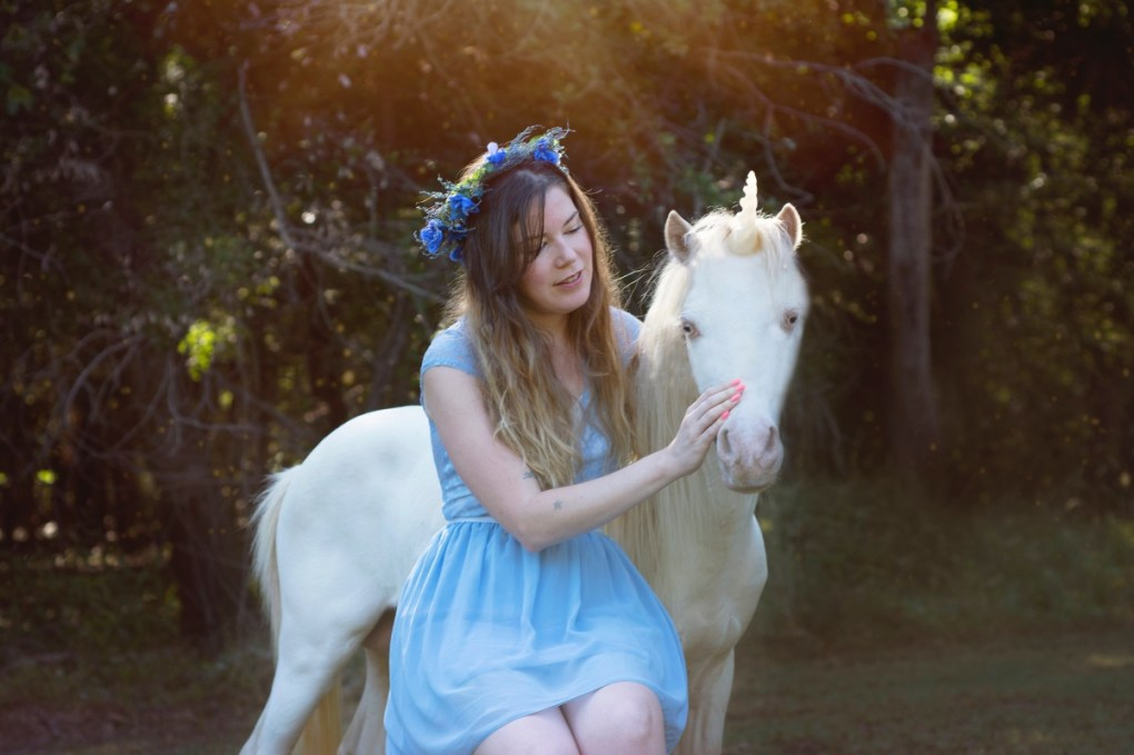brittany with a unicorn in the meadow magical photography