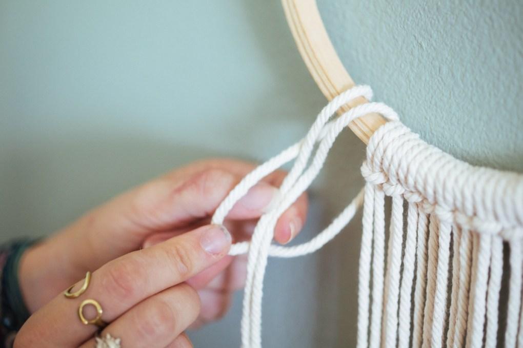 pull the loop through a balloon loop - diy wall hanging macrame