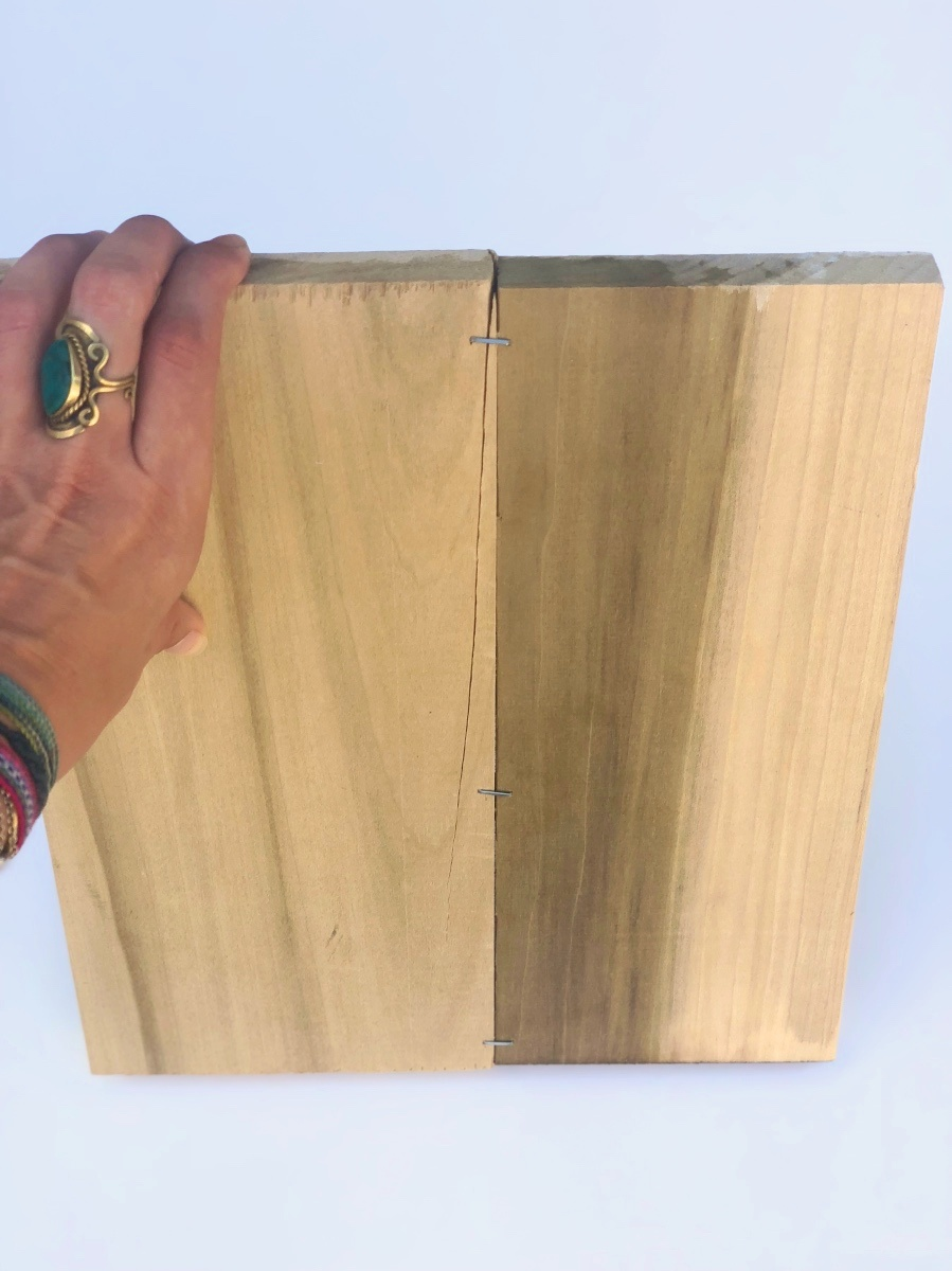 staple the wood planks together to make a rustic wood sign_light