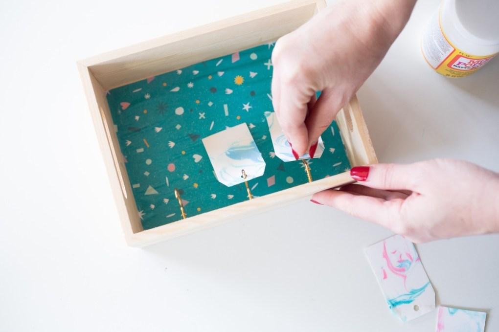 mounting the c hooks into the wood - desktop calendar diy