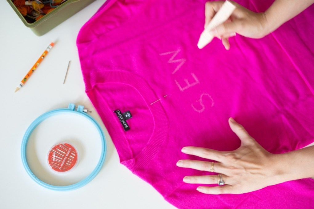 write the words in chalk to make an embroidered sweater