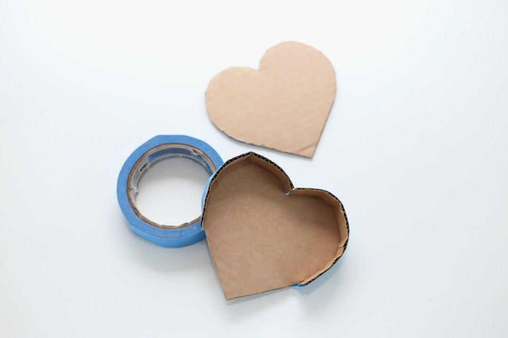 cardboard and tape to make a diy heart shaped pinata pop shop america