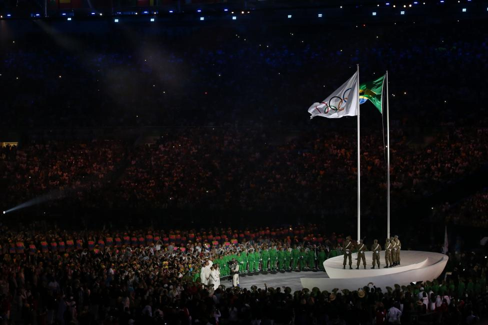 The Olympic flag is risen. REUTERS/Andrew Boyers