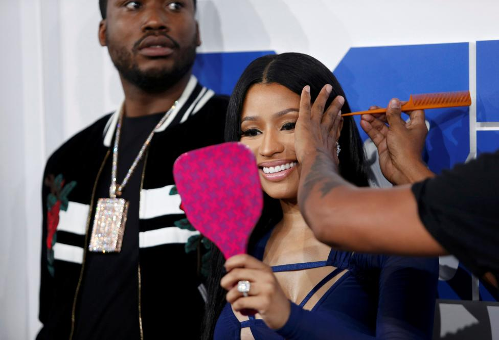 Rapper Nicki Minaj has her hair touched up as she arrives. REUTERS/Eduardo Munoz