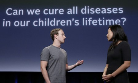 In this Tuesday, Sept. 20, 2016, photo, Facebook CEO Mark Zuckerberg, left, speaks with his wife, Priscilla Chan, as they rehearse for a speech in San Francisco. Zuckerberg and Chan have a new lofty goal: to cure, manage or eradicate all disease by the end of this century. To this end, the Chan Zuckerberg Initiative, the couple's philanthropic organization, is committing significant financial resources over the next decade to help accelerate basic science research. (AP Photo/Jeff Chiu)