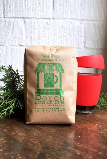 Handcrafted Christmas Blend Coffee with Coffee Mug and Festive Holiday Greenery