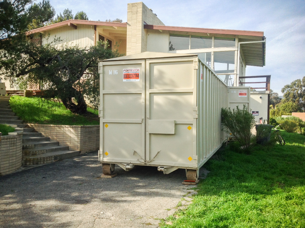 26ft container on wood to protect the driveway.