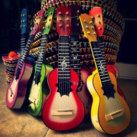 a stack of colorful guitars