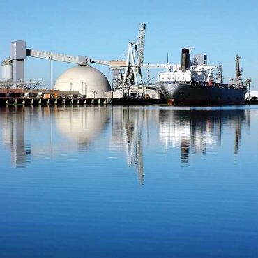Water view of a cargo ship docked in port