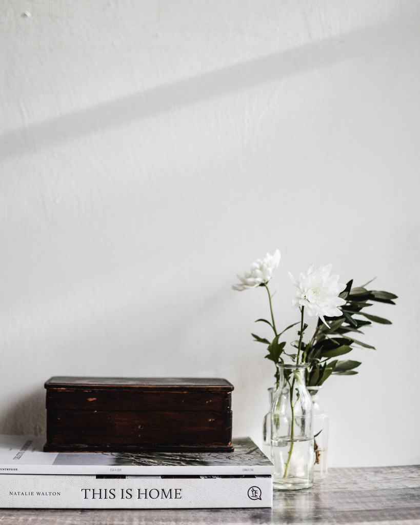 still life of flowers and books