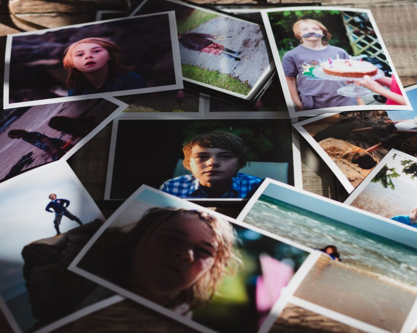 photographs scattered on a table