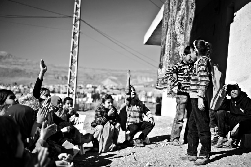 Kids having acting class - Gestures in the photo are very strong and describing song's sentence: It's my right to learn