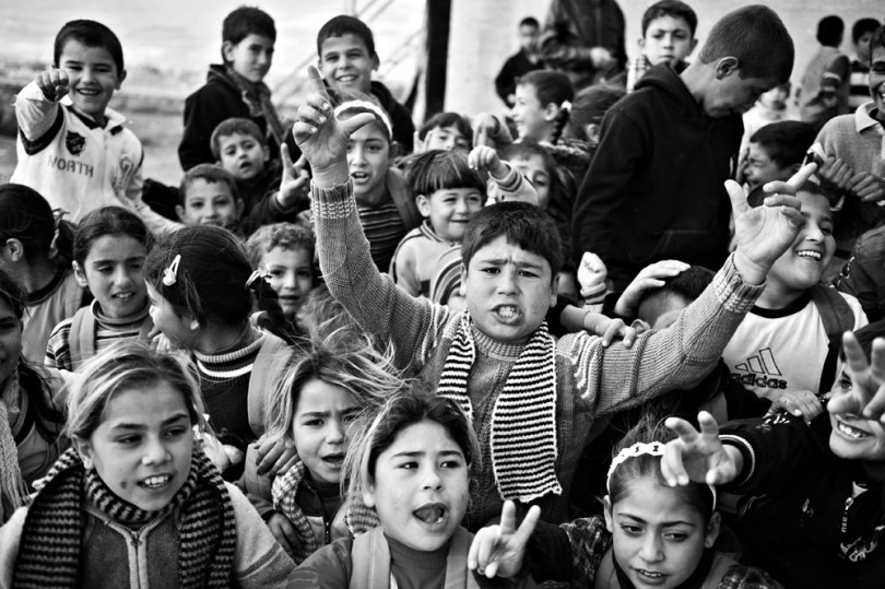 Group of kids singing that song -Photo full of different emotions describing complite song.