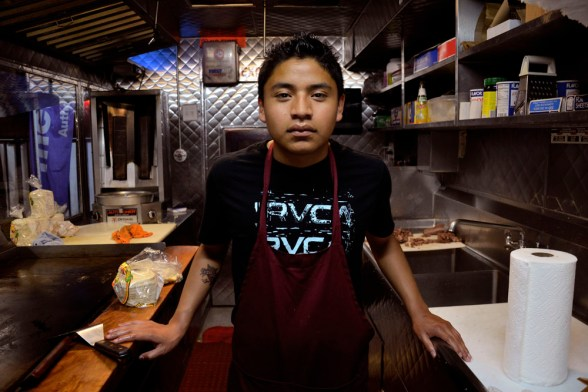 Young mixteco working at a food truck, Oxnard, CA