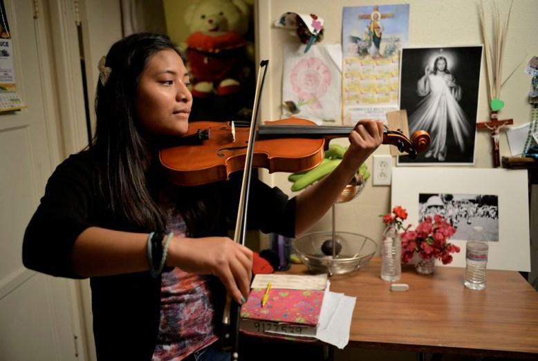 Alondra young Mixteca playing violin in Oxnard, CA