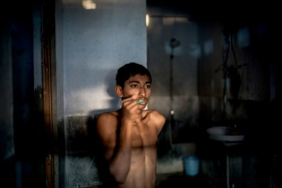Buddhadeb Das(18) is brushing his teeth. He is actually hails from Shantipur, a small town which is about 60 miles away from Kolkata. He has been staying at the academy from beginning.