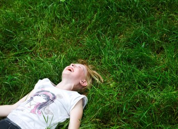 Natalia Varauka laughs in the long grass at the Narbeth Forest School after playing a game of twister. The children will spend up to a month with host families around the Pembrokeshire area of the U.K. An astonishing 85 per cent of Belarusian children are deemed to be Chernobyl victims: they carry Ògenetic markersÓ that could affect their health at any time and can be passed on to the next generation. A vicious cycle that unfortunately could continue for hundreds if not thousands of years. From the series 'The Healing Land'