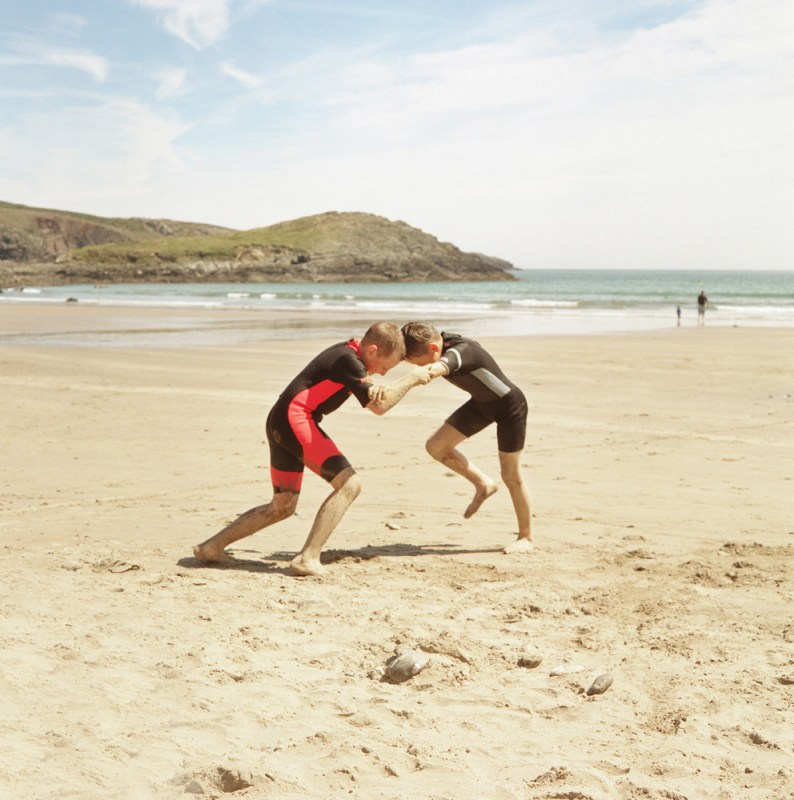 Yury Dubinchyk and Artur Dubanevick wrestle on the beach at Whitesands Bay, Pembrokeshire, U.K. The children will spend up to a month with host families around the Pembrokeshire area of the U.K. An astonishing 85 per cent of Belarusian children are deemed to be Chernobyl victims: they carry Ògenetic markersÓ that could affect their health at any time and can be passed on to the next generation. A vicious cycle that unfortunately could continue for hundreds if not thousands of years. From the series 'The Healing Land'