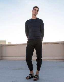 Pasha wears Opening Ceremony sweater Loewe Pants Birkenstock shoes