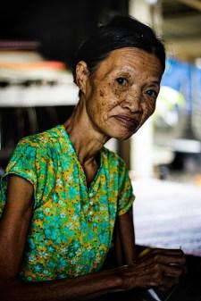 Elderly woman weaving a sleeping mat in the rural villages of Hội An