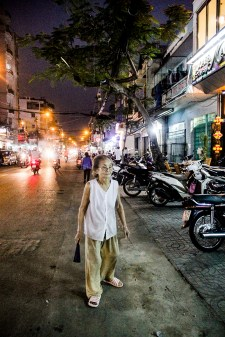 Elderly woman in the streets of Saigon