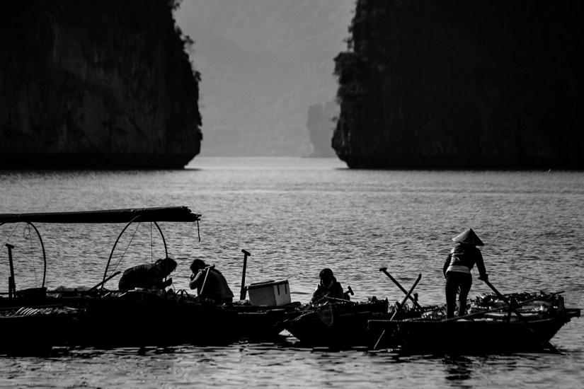 Women fishing in boats in Ha Long Bay.