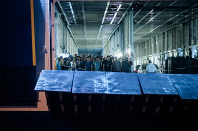 """Refugees and migrants disembark the ship """"Tera Jet"""" in the port of Pireaus, Greece on September, 3 2015. The ship arrived from the island of Lesbos where the larger amount of refugees and migrants arrive after crossing the Aegean Sea from Turkey"""
