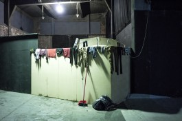 Clothes are left to dry inside an abandoned building temporary used as shelter for refugees and migrants in the port of Piraeus near Athens. The Balkan trail from Greece to northern Europe used by floods of migrants was blocked in early March 2016.